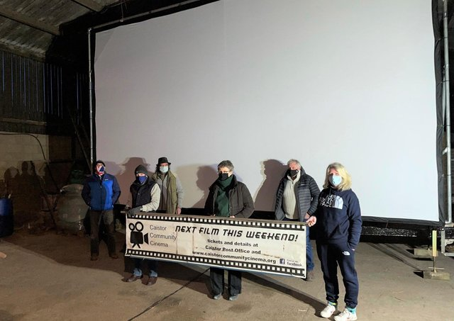 Members of the Caistor Community Cinema team in front of the mega screen