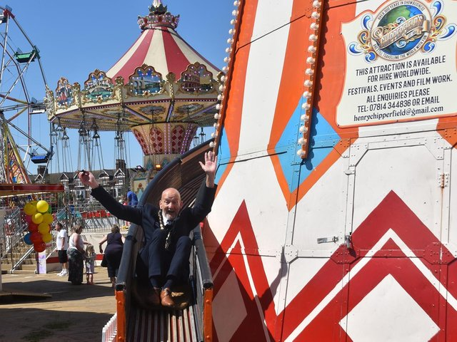 Having the time of his life... Mayor Coun Trevor Burnham on the Helter Skelter.