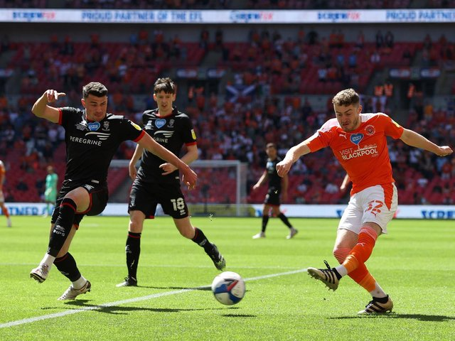 Blackpool's Elliot Embleton shoots whilst under pressure from Max Sanders. (Photo by Catherine Ivill/Getty Images)