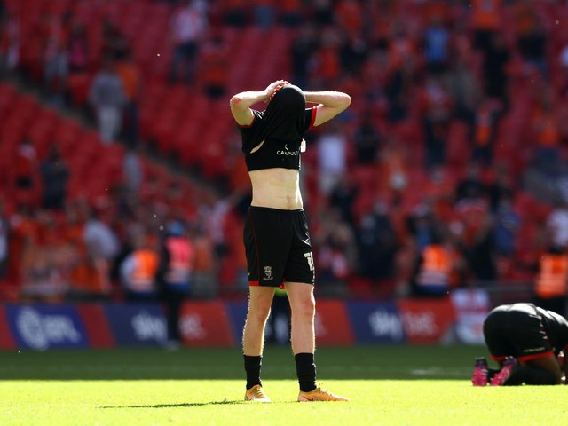 Callum Morton of Lincoln City looks dejected after the Sky Bet League One Play-off Final match between Blackpool and Lincoln City at Wembley Stadium. (Photo by Catherine Ivill/Getty Images)
