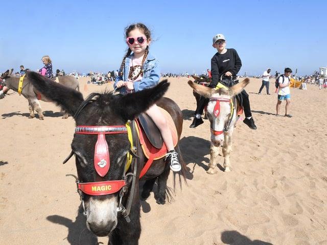 Fearne Harrison, 3, enjoying a ride on the donkeys on Skegness beach.