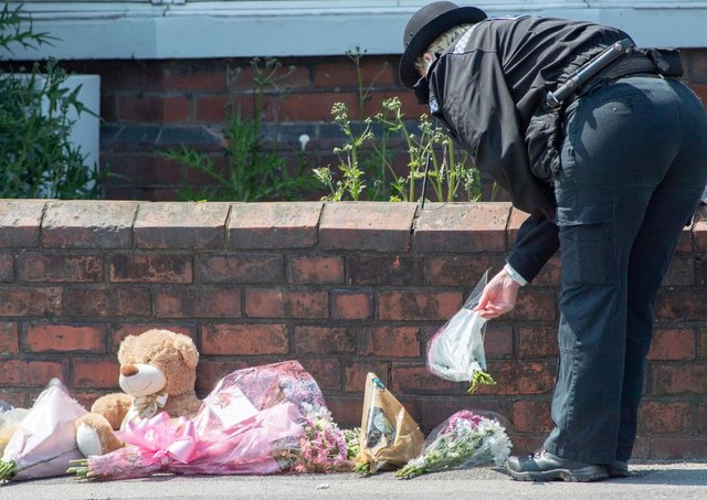 Tributes have been left outside the property in High Holme Road.