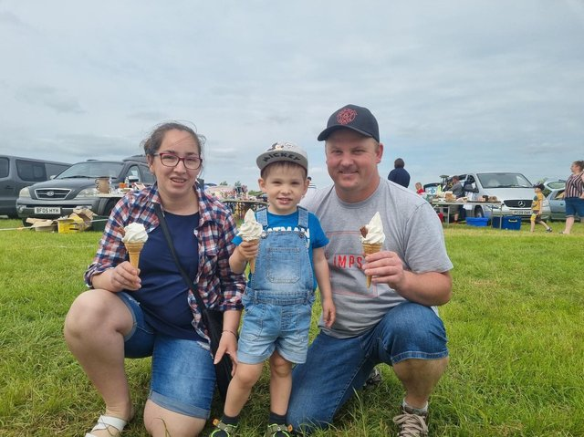 The Kerso family from Skegness enjoying an icecream at Burgh le Marsh car boot sale.
