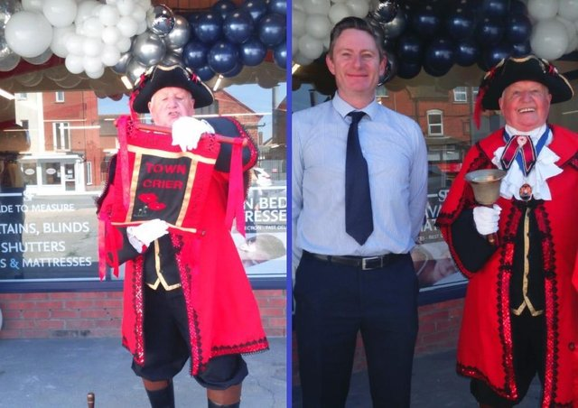 Town Crier David Summers (left), and pictured with shop owner Andrew Squires.