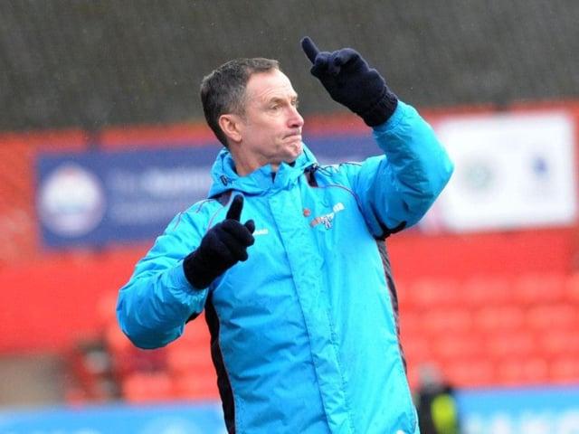 United assistant John McDermott.