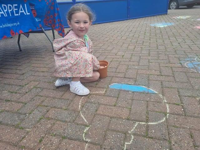 Masi Andrews, 5, of Tamworth, Birmingham, colouring in a poppy.