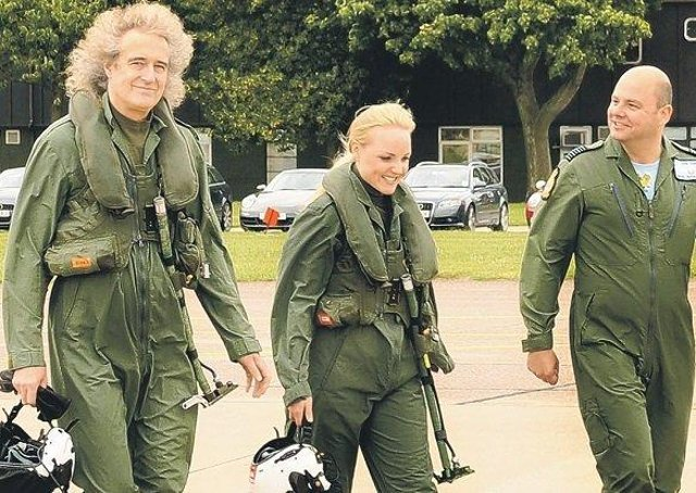 Brian May and Kerry Ellis with Group Captain Dave Waddington, station commander at RAF Cranwell.