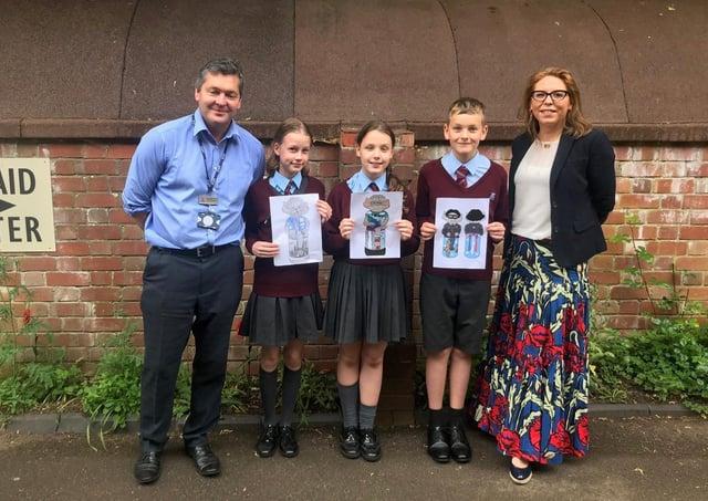 William Alvey School headteacher, Stephen Tapley and Affinity's Alex Davison and pupils holding some of their Imp designs. EMN-210618-123635001