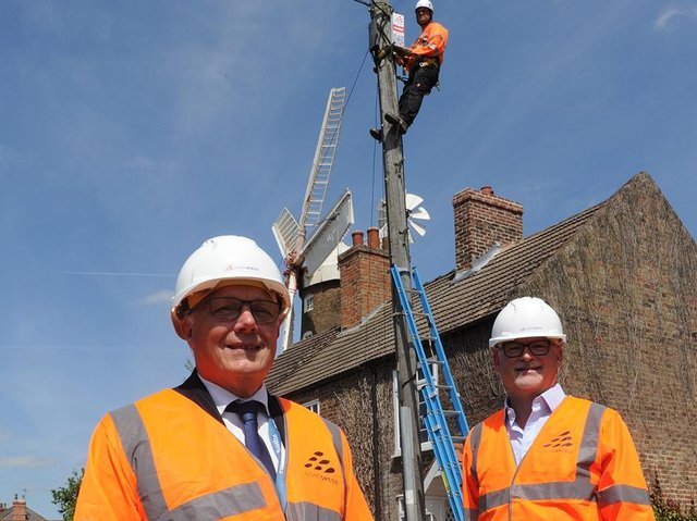 (L-R) Coun Paul Skinner (left), Leader of Boston Borough Council and Dave Axam, Chief Operating Officer at Lightspeed Broadband celebrating the progress of Lightspeed Broadband's network build in front of Maud Foster Mill in Boston.