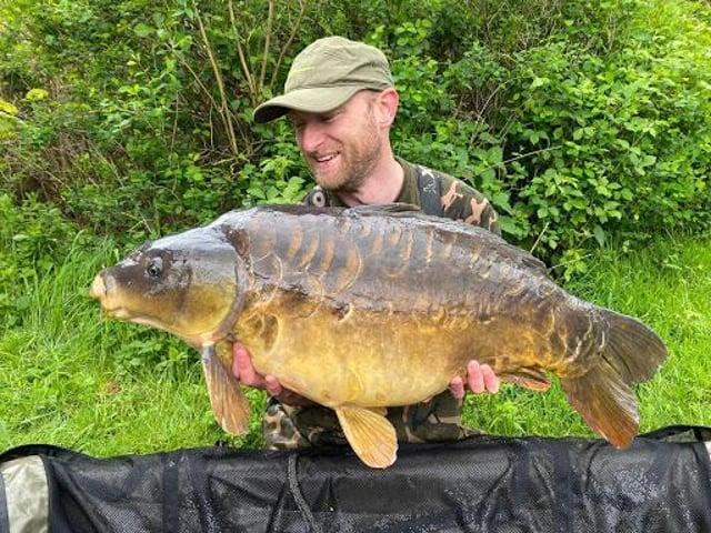 Dan Smith with a 40lb mirror carp.