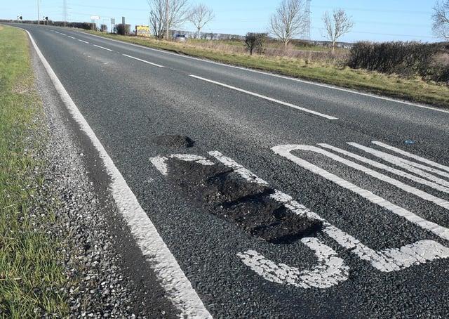 Potholes on the A15. EMN-210624-171823001