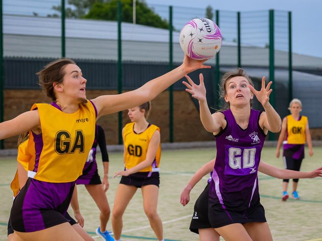 Netball action by David Dales.