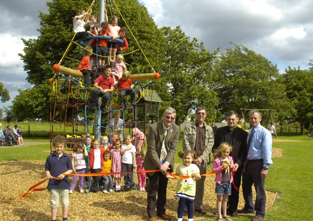 Coun Peter Bedford officially opening the new play equipment in Freiston 10 years ago. Pictured holding the ribbon (from left) are Charlie Fairman, seven, Gabriella Bedford, four, Cerys Horrey, seven. Pictured (back, from left) Coun Bedford, John Wright and Alistair Godwin, management committee for playing field association, and the Rev Andrew Higginson.