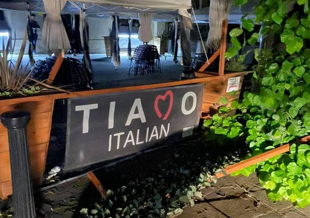 Wrecked trellis and planters outside Tiamo Italian restaurant in Sleaford market place after the England match. EMN-211207-133030001
