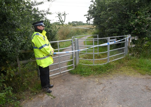 Police incident on Mareham Pastures. Officers stand guard at the gateway from Lavender Close.. EMN-211207-114535001