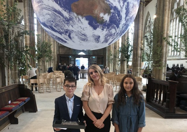 William Alvey School pupil sDavid and Ithar with Year 6 teacher Natalie Mason at Hull Minster for the centenary service. EMN-210823-175650001