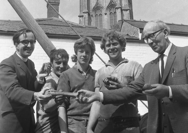 Pictured examining the bones are (from left) Mr Duce, site workmen Terry Kirk, Alan MacIntyre and Sebastian Dangerfield, and Mr R. Baker, the parish church verger.