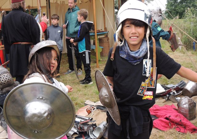 Juliet and Alex Rowles of Dowsby check out the medieval armour at Folkingham Heritage Festival. EMN-210920-133242001