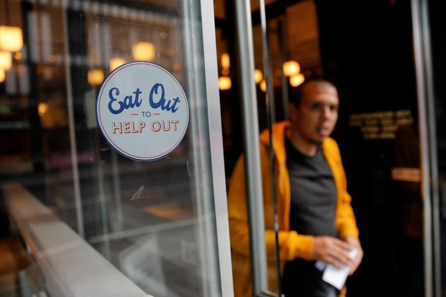 The scheme was designed to give struggling hospitality businesses a financial boost during the pandemic (Photo by TOLGA AKMEN/AFP via Getty Images)