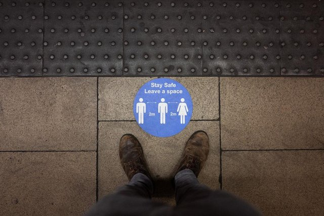 A social distancing sticker is seen on an underground station platform ahead of the evening rush hour in London (Photo: Leon Neal/Getty Images)