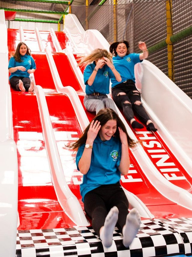 Staff at Play World Gainsborough try out the new slide as it welcomes back customers