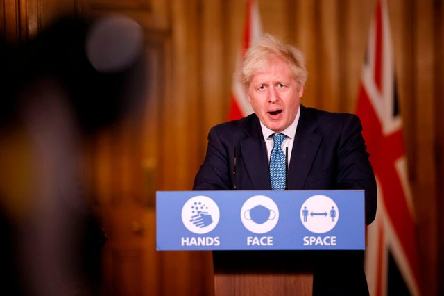 Boris Johnson speaks during a virtual press conference inside 10 Downing Street this afternoon (Photo by TOLGA AKMEN/AFP via Getty Images)