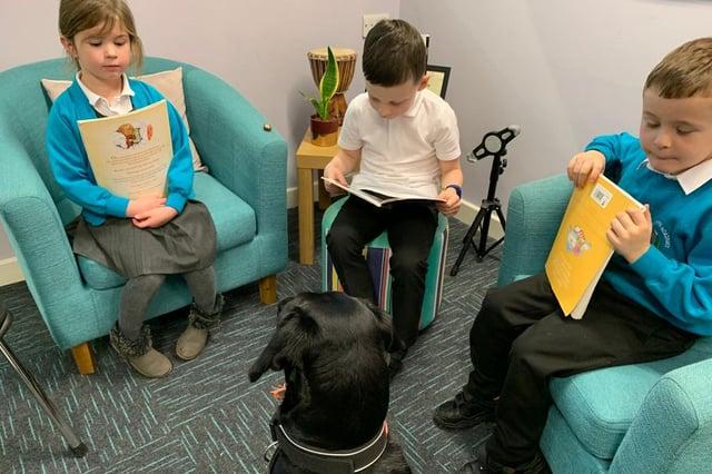 Margo listens to the children read