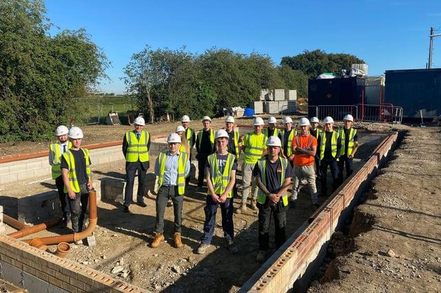 Steve Gelder (third from left) with 16 Gelder Group apprentices on site at Sturton by Stow