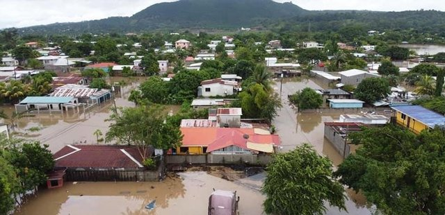 A flooded community in Honduras following two hurricanes last month.